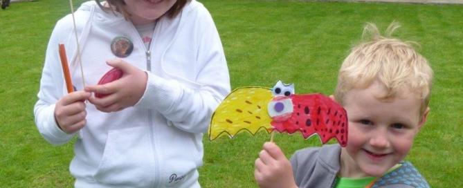 Kids holding their bat crafts
